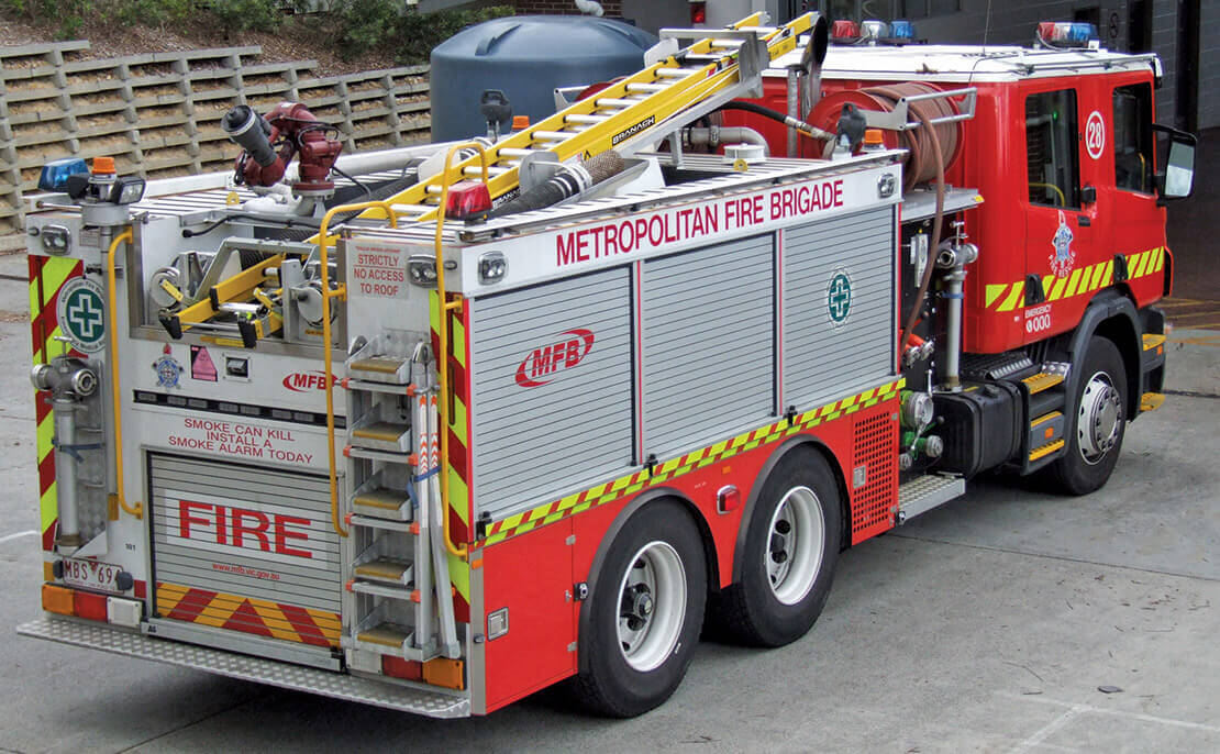 A fibreglass PowerMaster Extension ladder strapped to the top of a Metropolitan Fire Brigade truck.